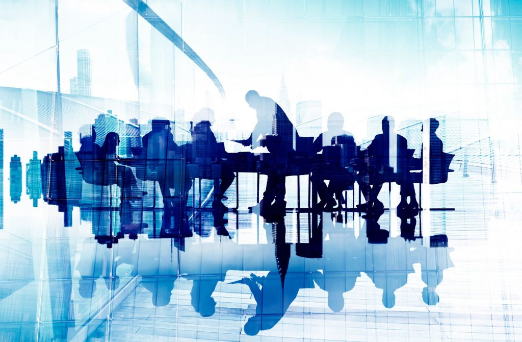employees in a conference room for corporate communication. employee communications is an important part of your internal messaging strategy.